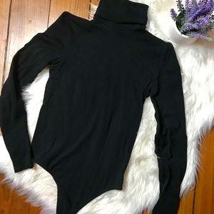 Black long sleeve turtleneck bodysuit.
